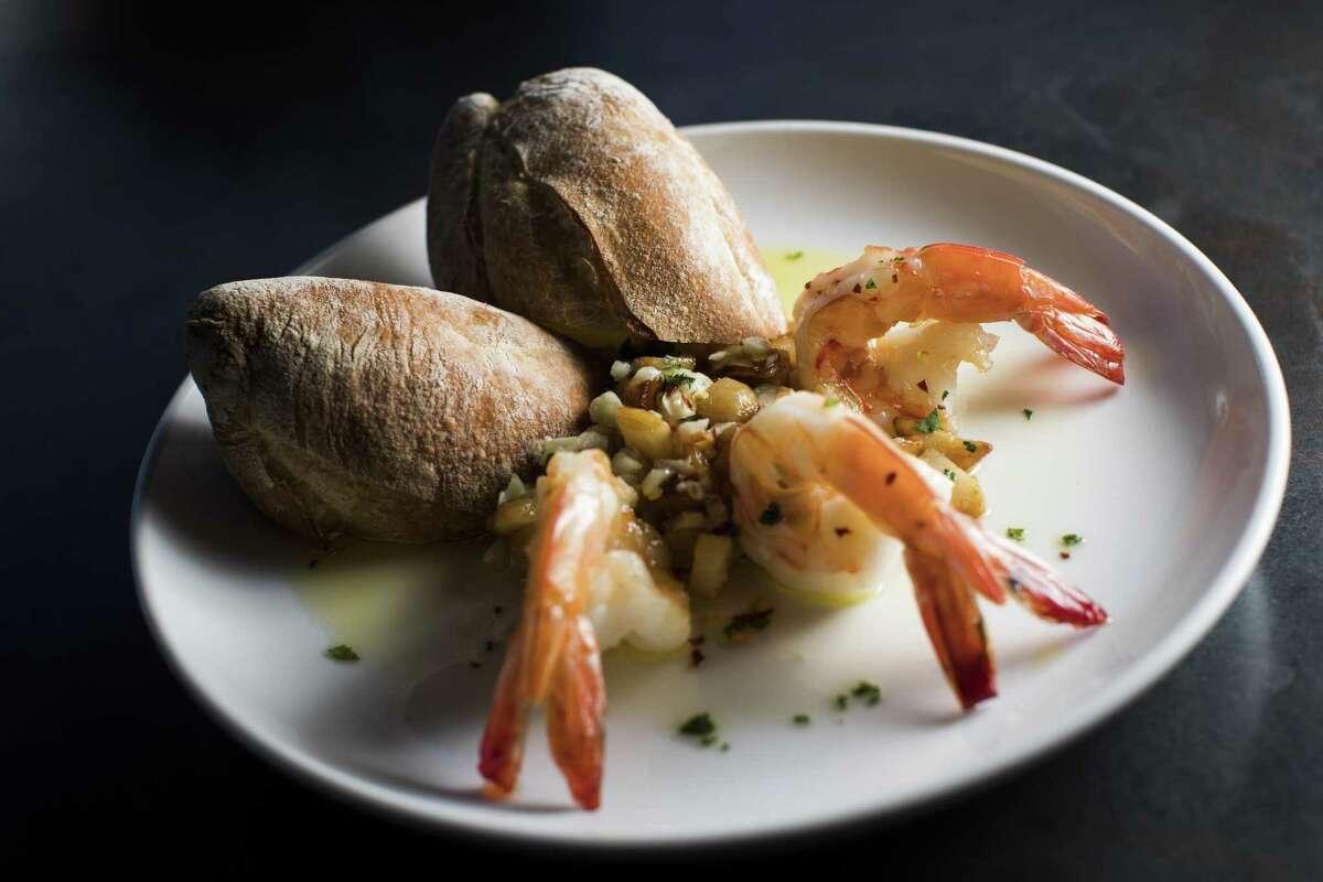Jumbo Shrimp sautéed with roasted and fresh garlic at Costa Brava Bistro