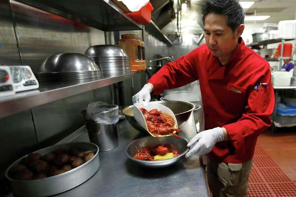 Trong Nguyen prepares an order of crawfish.