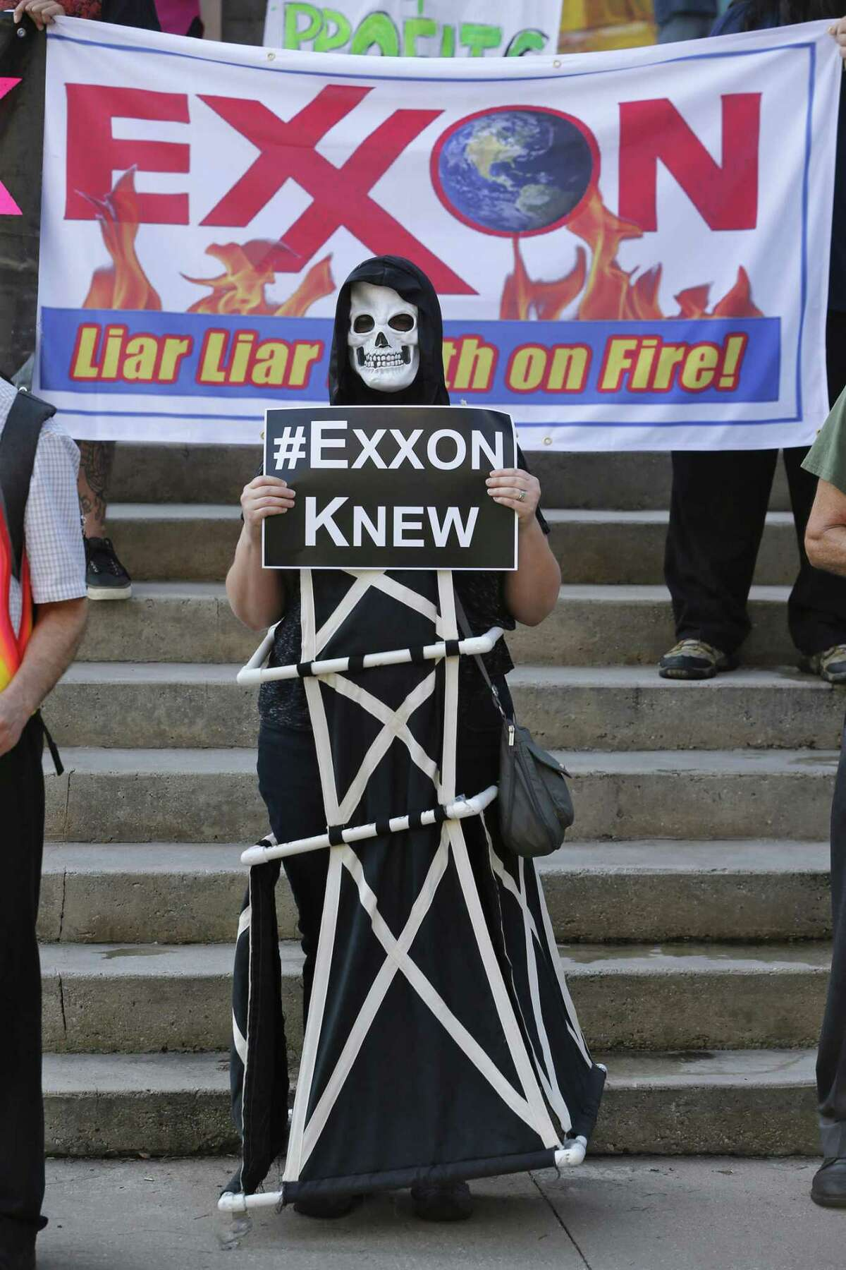 Shannon Carter wears a skeleton mask while dressed as an oil rig as protesters gather outside of the Exxon shareholders meeting across the street from the Morton H. Meyerson Symphony Center in Dallas on Wednesday, May 31, 2017. Exxon Mobil announced Thursday it was joining a corporate coalition working toward the goals of Paris climate change agreement.(Nathan Hunsinger/Dallas Morning News/TNS)