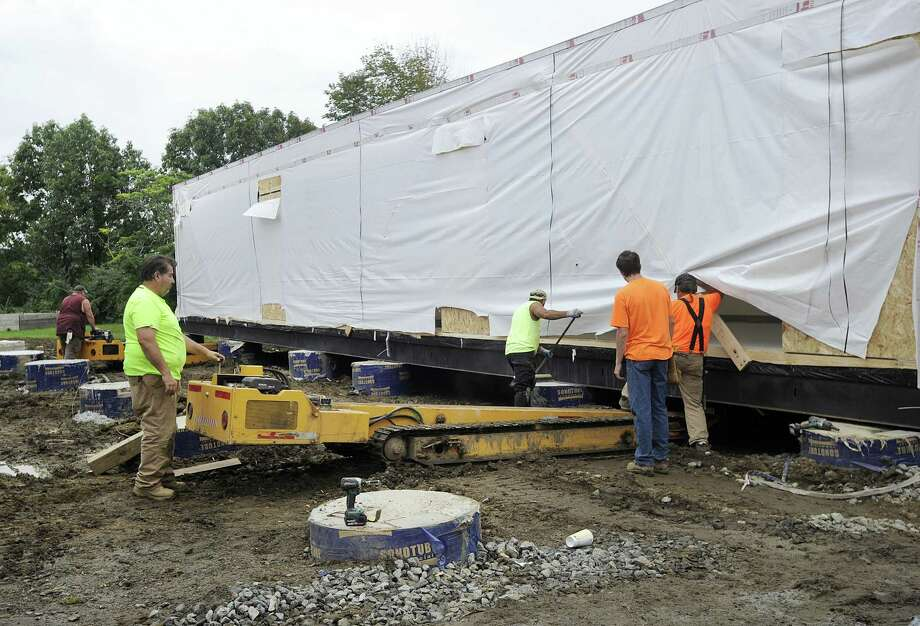 Crews are installing the new modular classroom additions for Westside Middle School Academy in Danbury, Friday, Sept. 21, 2018. Photo: Carol Kaliff / Hearst Connecticut Media / The News-Times