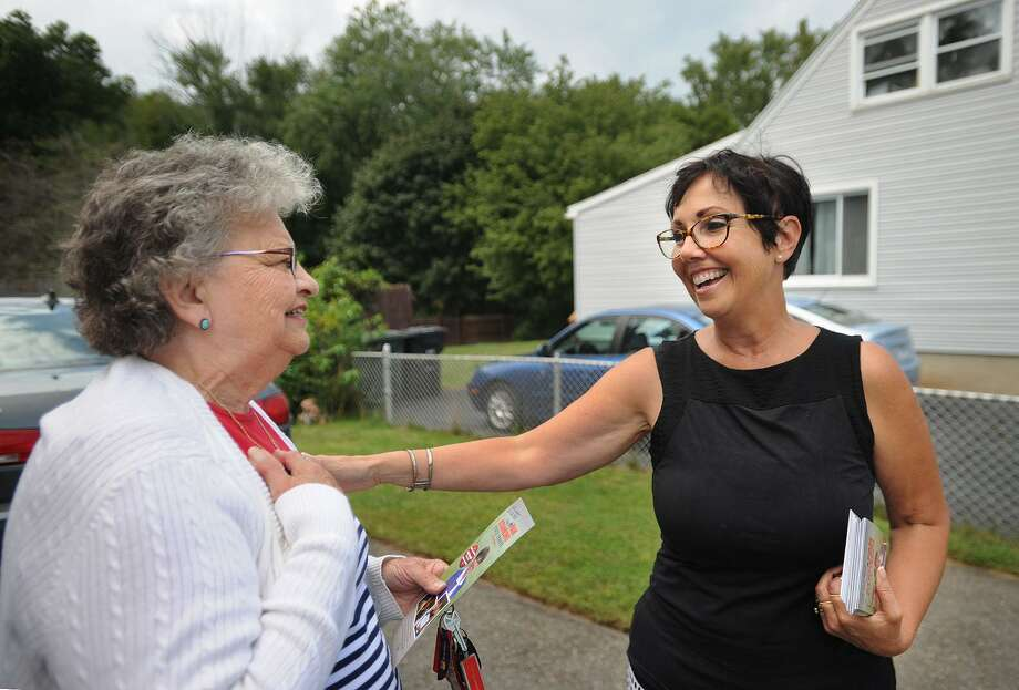 Republican candidate for state Senate District 14 Pam Staneski, right, greets voter Marie Busk while campaigning door to door on Harkness Drive in Milford, Conn. on Monday, September17, 2018. Photo: Brian A. Pounds / Hearst Connecticut Media / Connecticut Post
