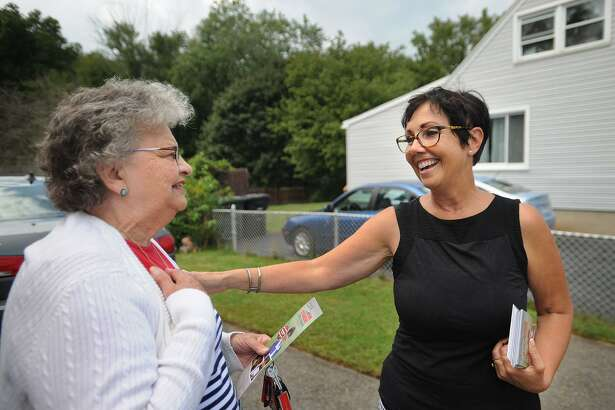Republican candidate for state Senate District 14 Pam Staneski, right, greets voter Marie Busk while campaigning door to door on Harkness Drive in Milford, Conn. on Monday, September17, 2018.