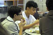 Shadman Ahmed, left, and Darian Ward, both 15, eat breakfast before the start of classes at Bethel High School Friday morning, Sept. 21, 2018. Breakfast is offered at the High School from 7:05 a.m to 7:30am. Friday 48 breakfasts were served. 11 at full price. 12 at a reduced price and 25 free.