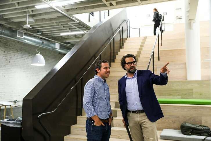 Base CEO Uzi Shmilovici chats with Zendesk CEO Mikkel Svane (right) at the Zendesk headquarters during happy hour in San Francisco, California, on Wednesday, Sept. 12, 2018. Zendesk acquired Base, a software startup and was welcoming the new employees.