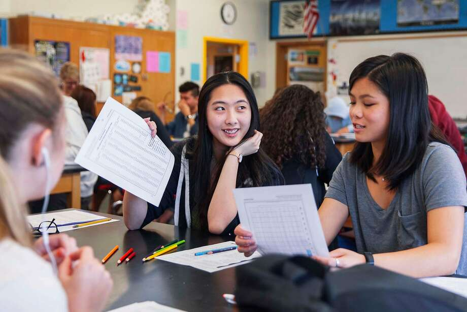 Melissa Lo (center), 16, goes over instructions for a group project with Megan Yes, 17, while attending Marine Sciences class at Lowell High School in San Francisco. Photo: Photos By Jessica Christian / The Chronicle