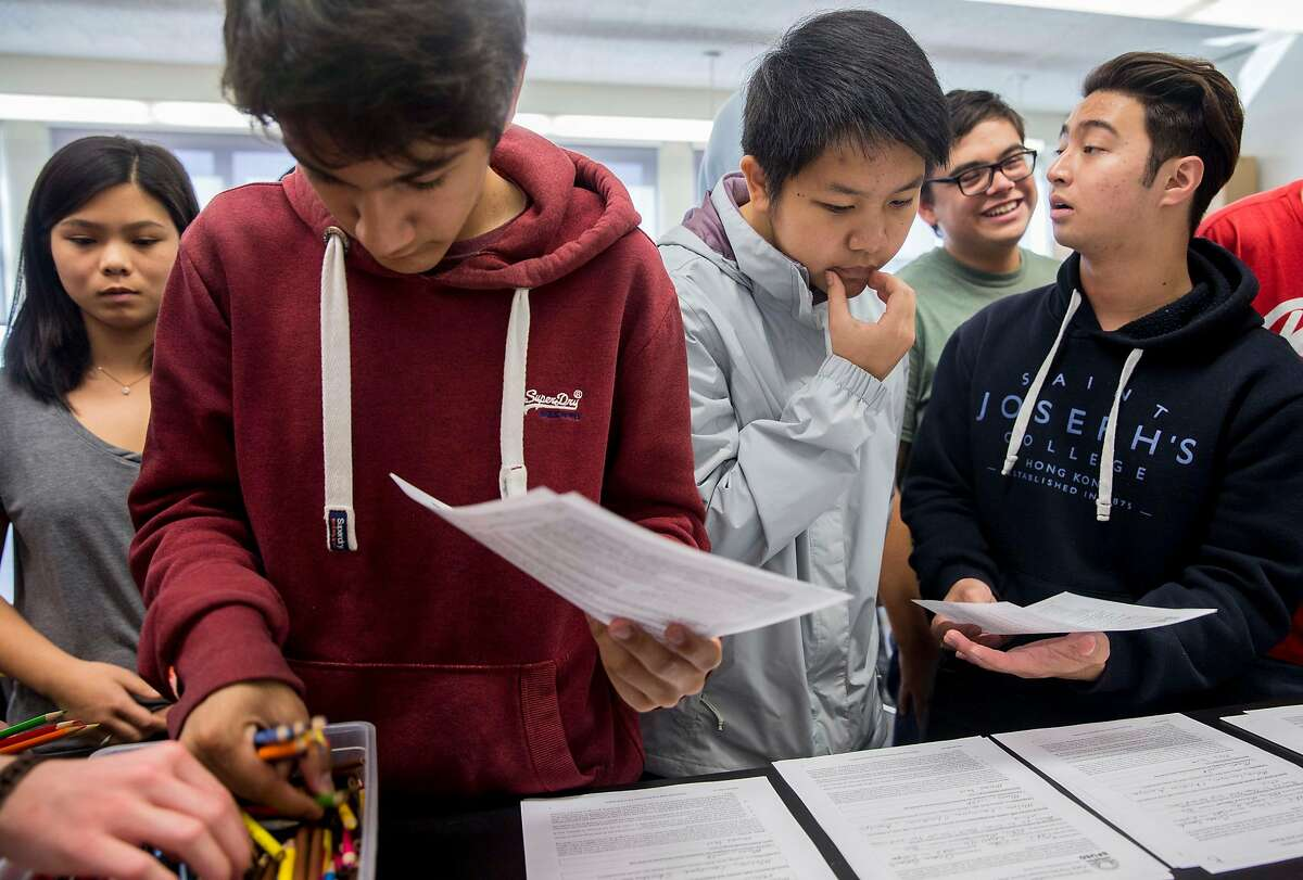 Students grab their supplies for a group project while in a Marine Sciences class at Lowell High School in San Francisco, Calif. Friday, Sept. 21, 2018.