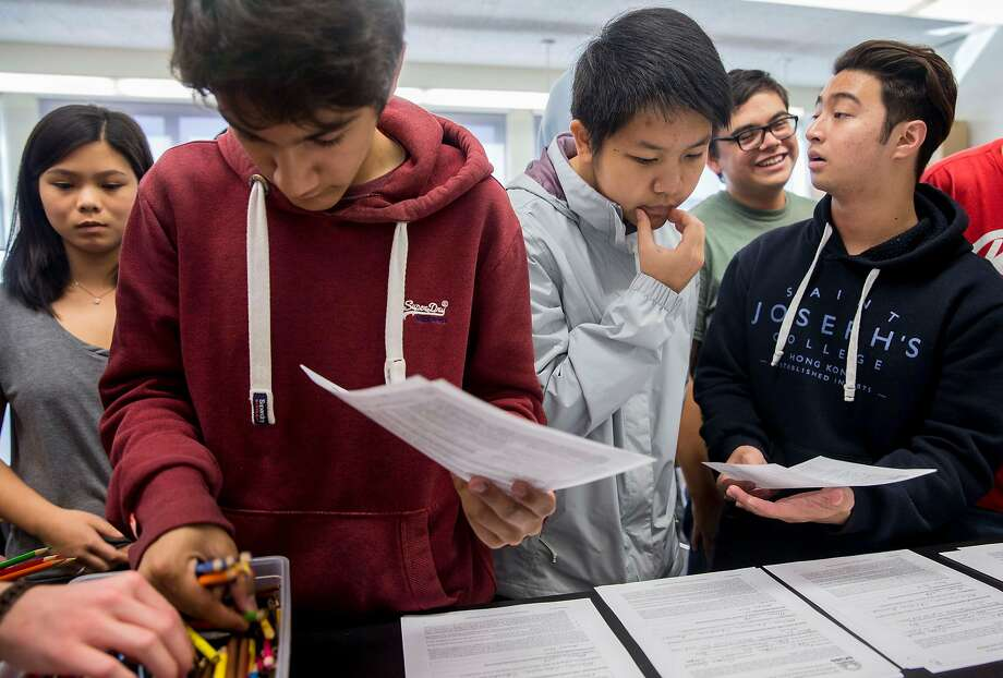 Students grab supplies for a marine sciences project at Lowell, which stresses academic achievement. Photo: Jessica Christian / The Chronicle