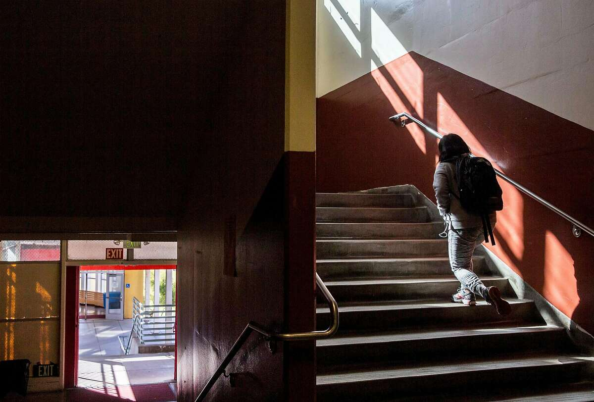 A student ascends the second floor steps on their way to class at Lowell High School in San Francisco, Calif. Friday, Sept. 21, 2018.