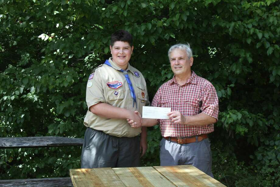 """Flanders Nature Center & Land Trust recently took delivery of four """"accessible"""" picnic tables from Charlie Stock of Boy Scout Troop #54 in Woodbury. The tables were constructed as part of his Eagle Scout project. Photo: Contributed Photo"""