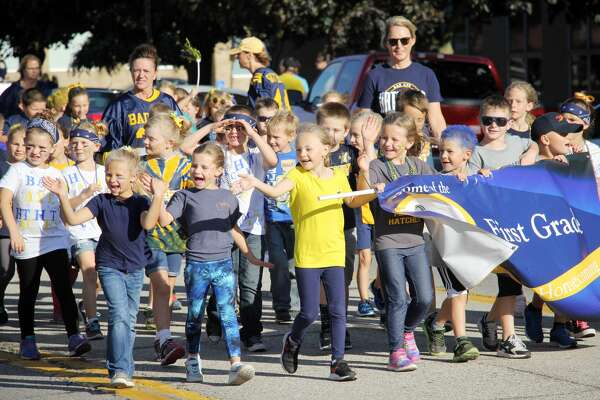 A few energetic first graders from Bad Axe Elementary get the crowd hype during Friday's Homecoming parade.