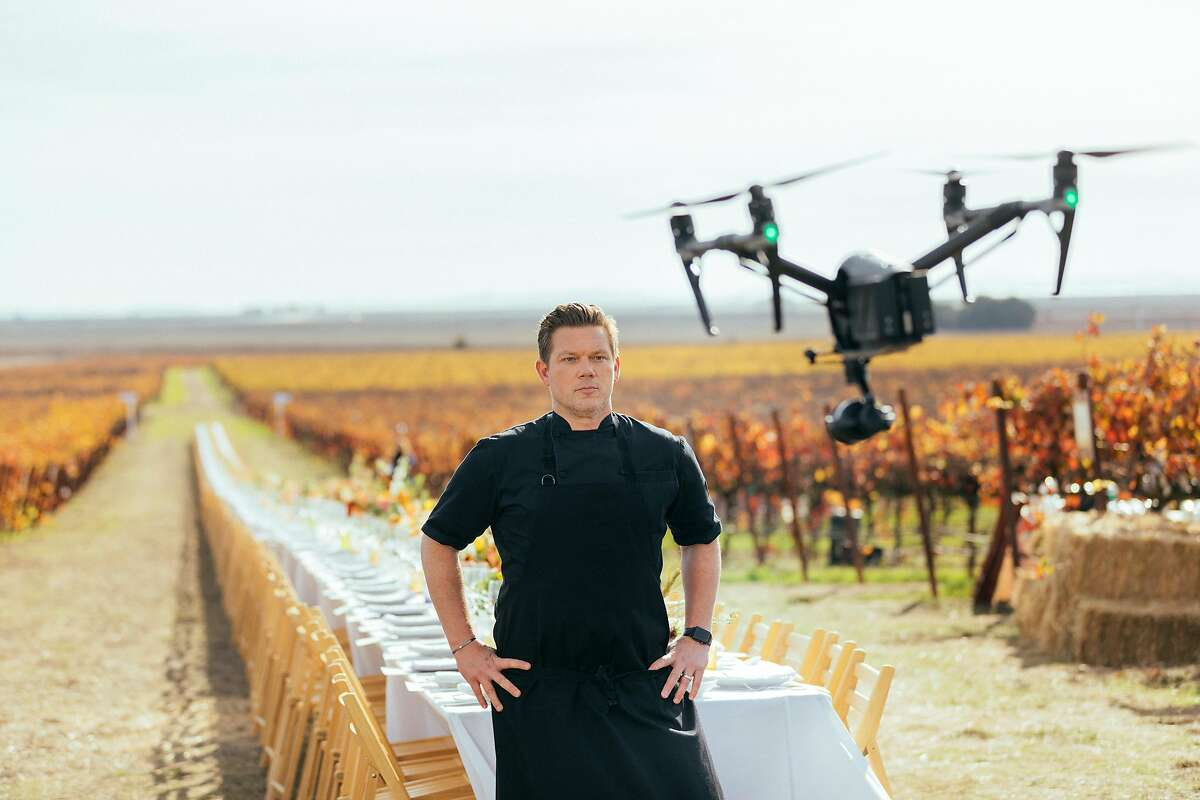 """Chef Tyler Florence poses before a drone during the filming of his documentary film, """"Uncrushable."""""""