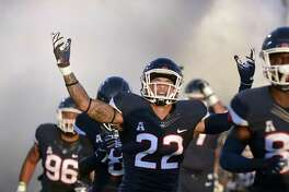 UConn linebacker Eli Thomas (22) and the Huskies' defense will try to apply some pressure on Syracuse on Saturday.