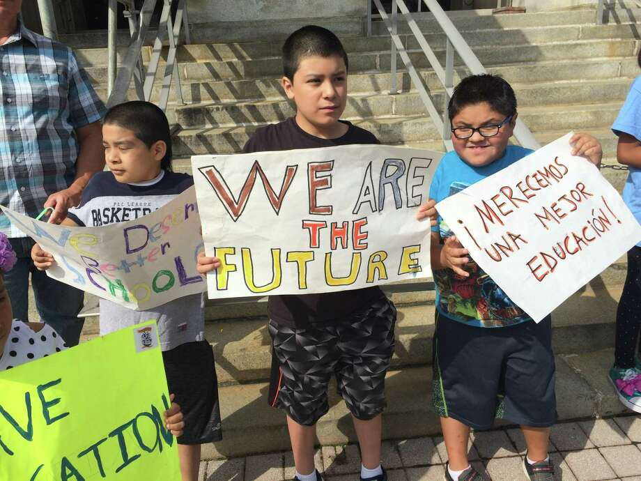 About 20 parents and children staged a protest outside of City Hall in Bridgeport Connecticut, on August 23, 2018 demanding better services for Latino students in the school district. Photo: John Burgeson