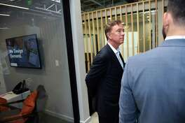 Democratic nominee for governor Ned Lamont listens to David Salinas, co-founder of the District Innovation and Venture Center, during a tour of the District Innovation and Venture Center in New Haven on September 21, 2018.