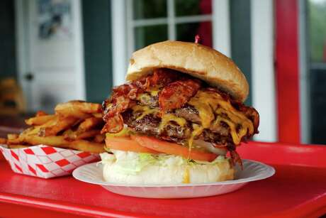 The Hubcap Double Meat 'n Cheese with Bacon and a side of fresh cut twice fried fries at the Hubcap Grill.