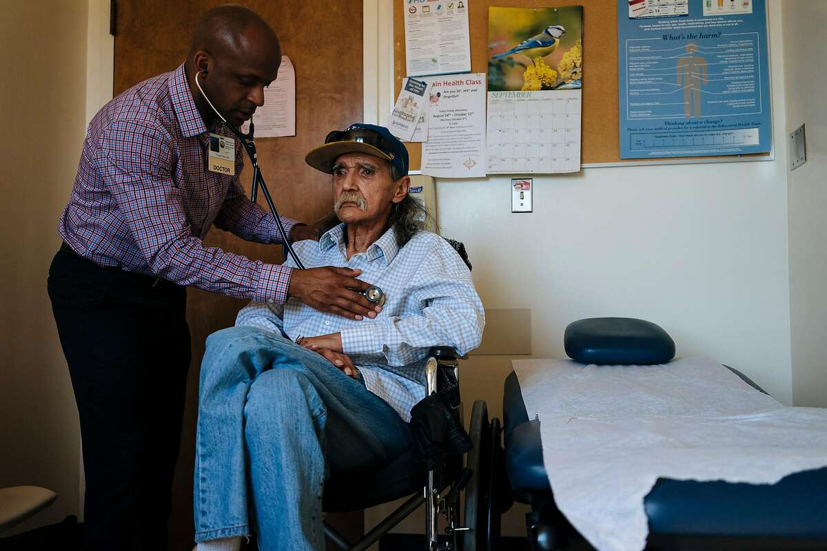 HIV health care provider, Hyman Scott, MD, checks the breathing of his patient, Richard Ramirez, 67, during a check up at the San Francisco General Hospital's Division of HIV/AIDS, Ward 86 in San Francisco, Calif., on Thursday, Sept. 20, 2018.