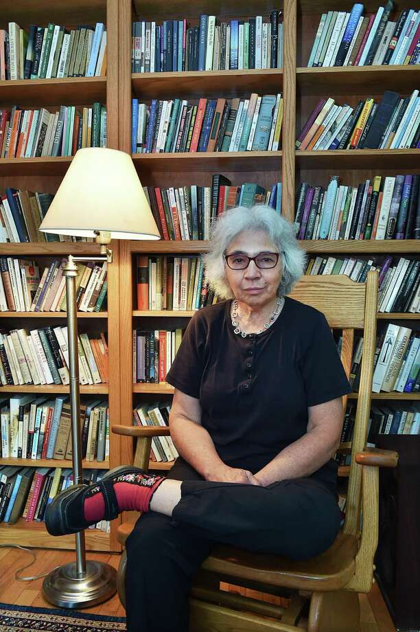 "Author Alice Mattison in her New Haven home, where she wrote her latest novel, ""Conscience."" Photo: Catherine Avalone / Hearst Connecticut Media / New Haven Register"