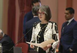 """In this photo taken Friday, Aug. 31, 2018, state Sen. Nancy Skinner, D-Berkeley, speaks on a bill before the Senate in Sacramento, Calif. Lawmakers approved Skinner's bill, SB1437, that limits the states """"felony murder"""" rule that holds accomplices to the same standard as if they had personally killed someone. (AP Photo/Rich Pedroncelli)"""