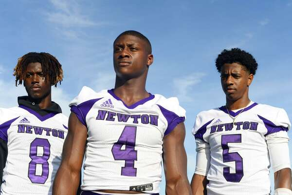 Newton players Tamauzia Brown, left, Darwin Barlow, center, and Josh Foster have committed to stay together in purple at Texas Christian University. Barlow plans to wait until signing day, and Foster will sign early. Photo taken Friday 9/14/18 Ryan Pelham/The Enterprise