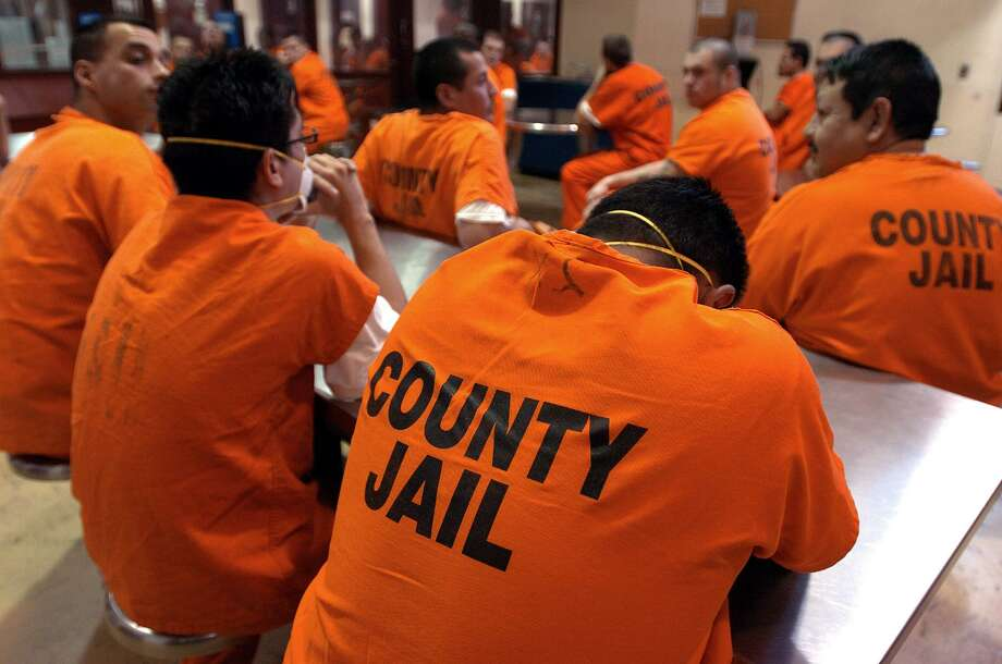 Inmates serve their time at the Bexar County Jail, July 28, 2004. The jail dealt with an over-crowding of inmates while detention officers were needed to work extra days to handle the overload. A reader defends the criminal justice system and asks what constitutes mass incarceration. Photo: KIN MAN HUI /SAN ANTONIO EXPRESS-NEWS / SAN ANTONIO EXPRESS-NEWS