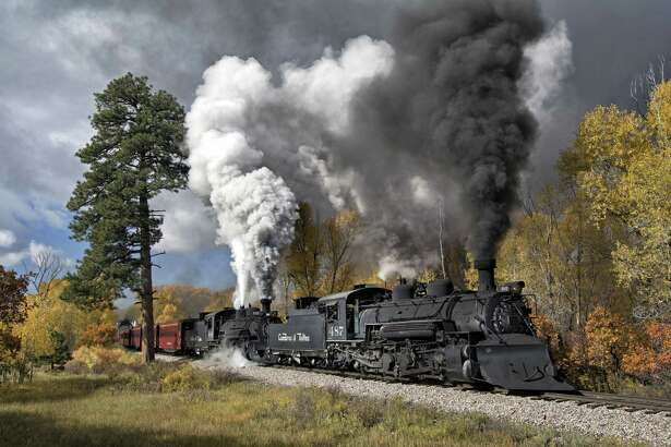 A pair of Cumbres & Toltec Scenic steam locomotives pull a passenger train near Chama, New Mexico.