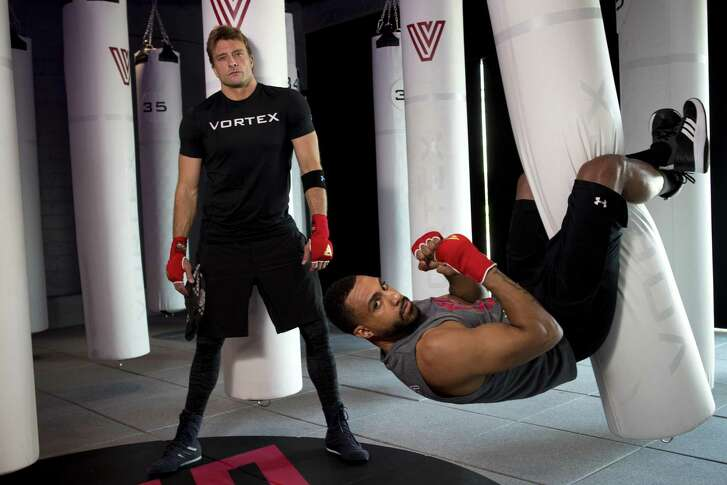 Athletes Casey Weeks, left, and Trey Blackwell offer a unique spin on the fitness gym at Vortex, which offers both boxing and spin classes rolled together.