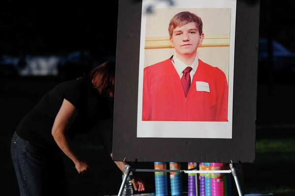 The memorial service in memory of Bart Palosz, pictured here in a poster photo, in Bruce Park, Greenwich, Conn., Thursday night, Aug. 27, 2015. The service marked the two year anniversary of Bart Palosz's suicide on the first day of his sophomore year at Greenwich High School.