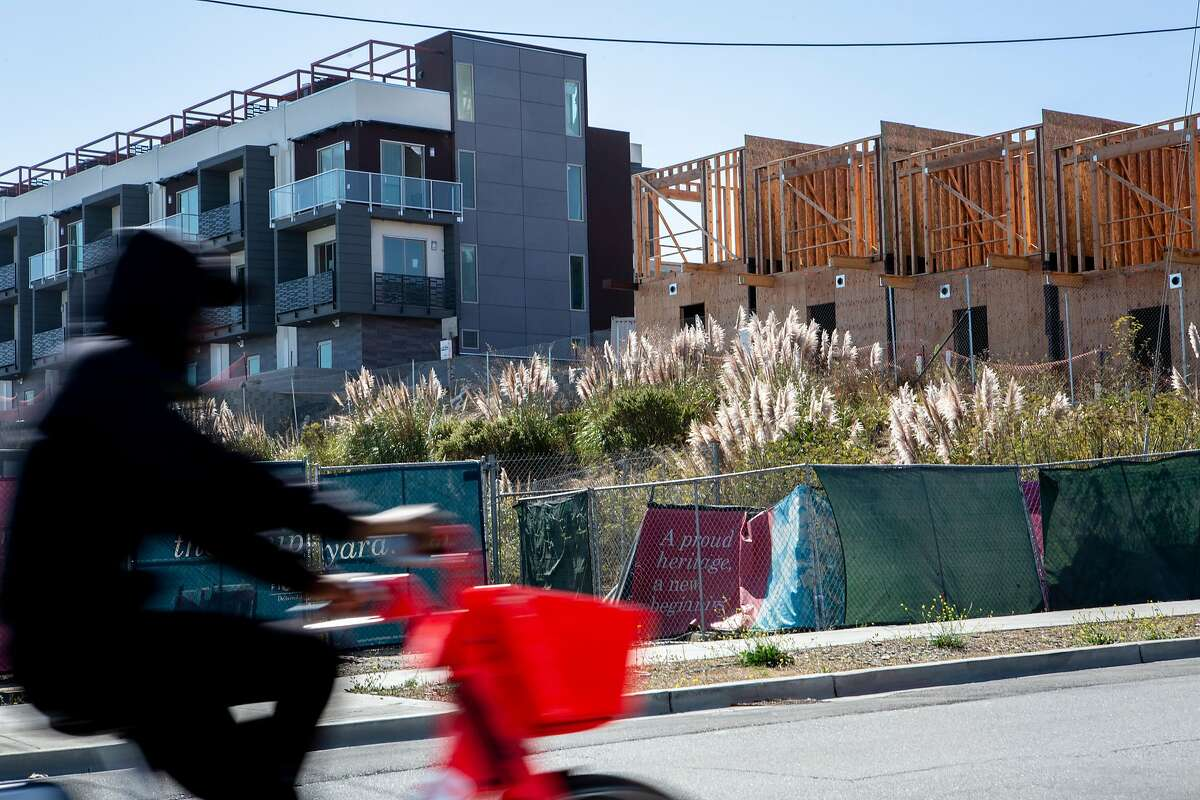 A man rides past the site where a radioactive deck marker was found near Donahue Street and Galvez Avenue at the former Hunters Point Naval Shipyard., Friday, Sept. 21, 2018, in San Francisco, Calif.