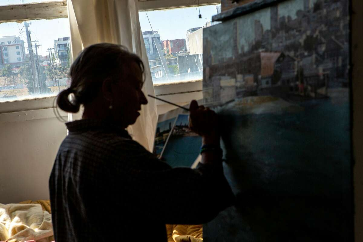 Eileen David paints at Building 125 at the Hunters Point Shipyard, Friday, Sept. 21, 2018, in San Francisco, Calif. A radioactive deck marker was found on Parcel A near Donahue Street and Galvez Avenue at the former Hunters Point Naval Shipyard. David is an artist working out of building 125 on Parcel B. She's been nurturing the cats near the site of the marker for the last three years.