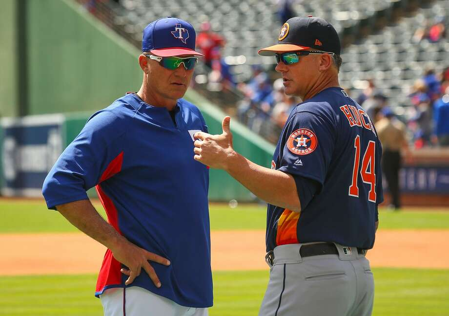 ARLINGTON, TX - MARCH 29:  Manager Jeff Banister #28 of the Texas Rangers visits with Manager  AJ Hinch #14 of the Houston Astros during batting practice before the Opening Day game at Globe Life Park in Arlington on March 29, 2018 in Arlington, Texas.  (Photo by Richard Rodriguez/Getty Images) Photo: Richard Rodriguez/Getty Images