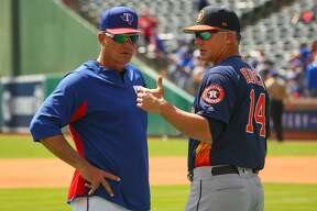 ARLINGTON, TX - MARCH 29: Manager Jeff Banister #28 of the Texas Rangers visits with Manager AJ Hinch #14 of the Houston Astros during batting practice before the Opening Day game at Globe Life Park in Arlington on March 29, 2018 in Arlington, Texas. (Photo by Richard Rodriguez/Getty Images)