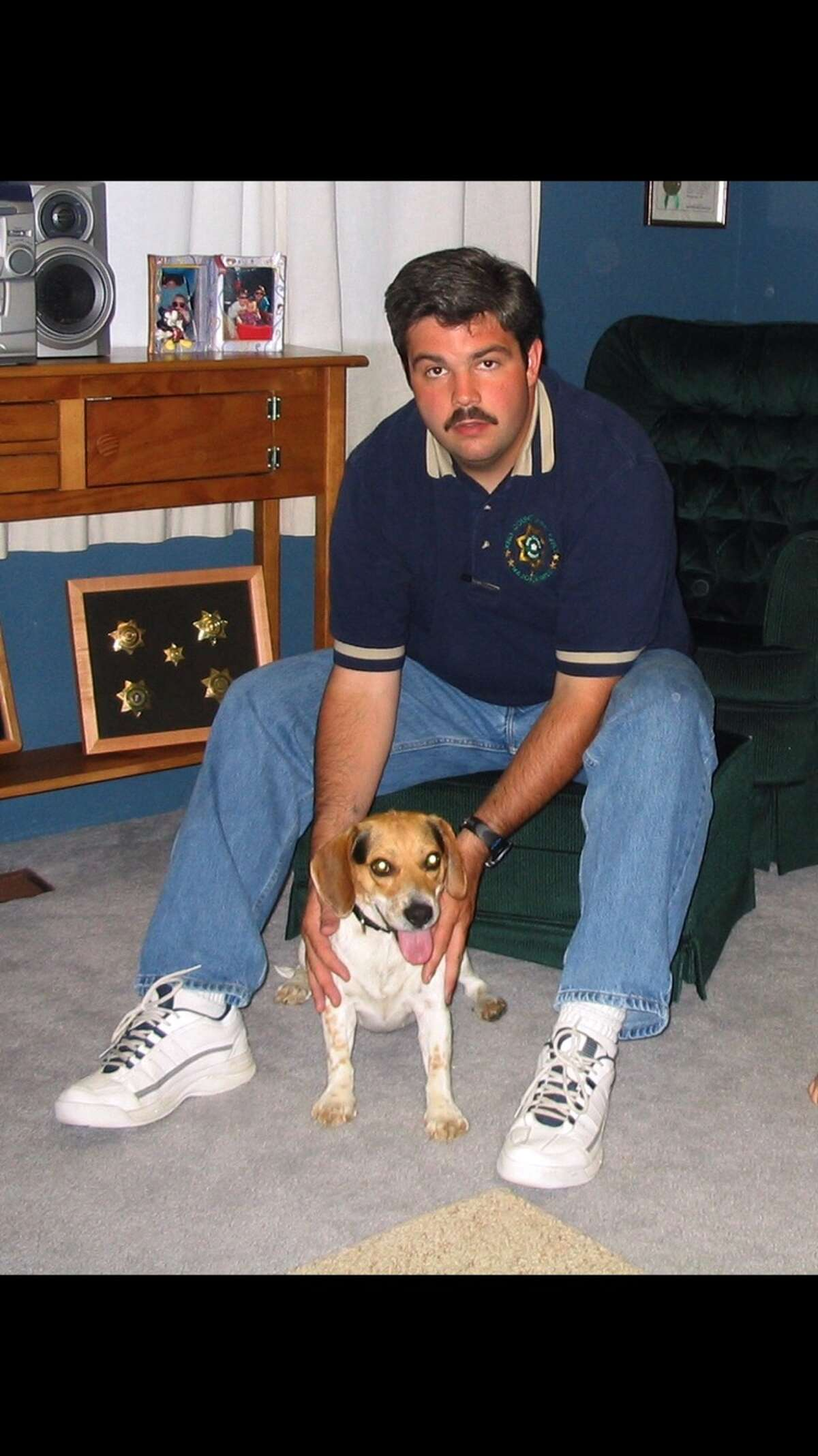 Scott Tompkins adopted a dog in 2003 that belonged to a couple accused of serial slayings in Raymond, Wash. Knowing the dog would likely be euthanized, he took the pup in, himself.