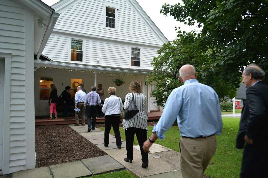 A group enters the circa 1780 Ferguson/Eno House that is featured on the 2018 Torrington House Tour. Photo: Leslie Hutchison / Hearst Connecticut Media /