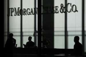 The JPMorgan Chase & Co. logo is displayed at their headquarters in New York on Oct. 21, 2013.