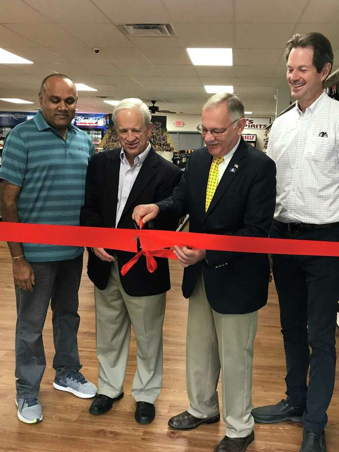 A ribbon cutting for a new package store opening in Barkhamsted on Route 44 was held Monday, Sept 17. It is located at 240 New Hartford Road, which has been the site of a number of businesses over the years. Most recently, Winsted Feed and Supply was the sole tenant, but the new owner, Ken Patel, subdivided the building. Winsted Feed will occupy half of the building and the new package store (Ken's Wine & Spirits) will be in the other half. This is the second store owned by Patel. Photo: Contributed Photo