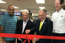 A ribbon cutting for a new package store opening in Barkhamsted on Route 44 was held Monday, Sept 17. It is located at 240 New Hartford Road, which has been the site of a number of businesses over the years. Most recently, Winsted Feed and Supply was the sole tenant, but the new owner, Ken Patel, subdivided the building. Winsted Feed will occupy half of the building and the new package store (Ken?'s Wine & Spirits) will be in the other half. This is the second store owned by Patel.