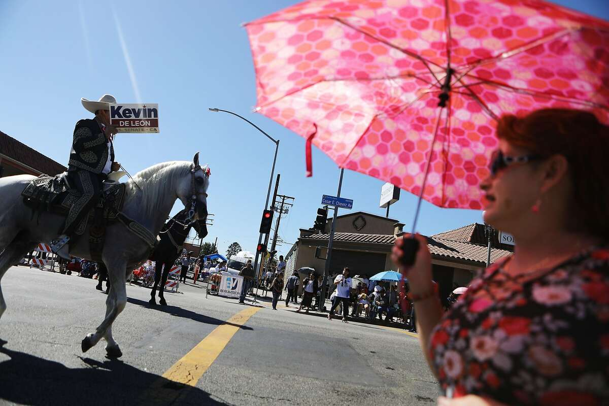 LOS ANGELES, CA - SEPTEMBER 16: A horseback rider carries a sign for U.S. Senate candidate Kevin de Leon during the 72nd annual East LA Mexican Independence Day Parade on September 16, 2018 in Los Angeles, California. 11.6 million immigrants from Mexico lived in the U.S. in 2016, making Mexico the top country of origin of U.S. immigrants, according to the Pew Research Center. (Photo by Mario Tama/Getty Images)