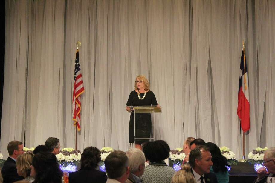 Children's Safe Harbor luncheon honrorary co-chair Lisa Michalk gives her keynote address at The Woodlands Waterway Marriott & Convention Center. Photo: Photographed By Marialuisa Rincon
