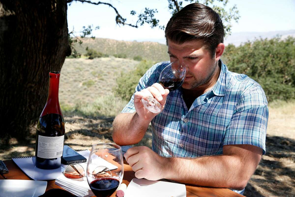 Joe Wagner smells Belle Glos wine during a tasting at a picnic table in the Las Alturas vineyard at the Santa Lucia Highlands in Monterey County, California, on Monday, April 18, 2016.