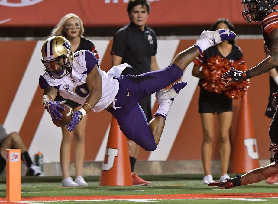With quarterback Jake Browning inconsistent, Washington relied on running back Myles Gaskin (abover) against Utah last week. Gaskin's 143 yards rushing included this touchdown. Photo: Gene Sweeney Jr. / Getty Images