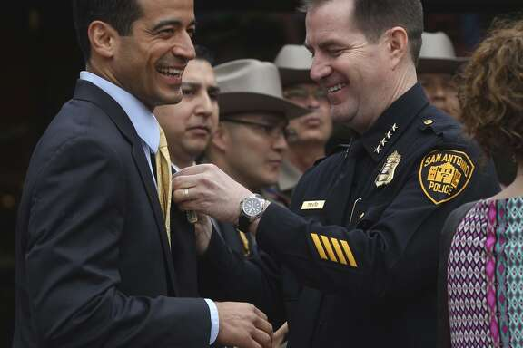 Bexar County District Attorney Nico LaHood (left) at a 2015 Fiesta ceremony with then-San Antonio Police Chief Anthony Treviño. In 2015, Treviño indefinitely suspended Officer Matthew Martin for allegedly altering evidence related to a drug arrest. LaHood's office twice declined to bring criminal charges against Martin.