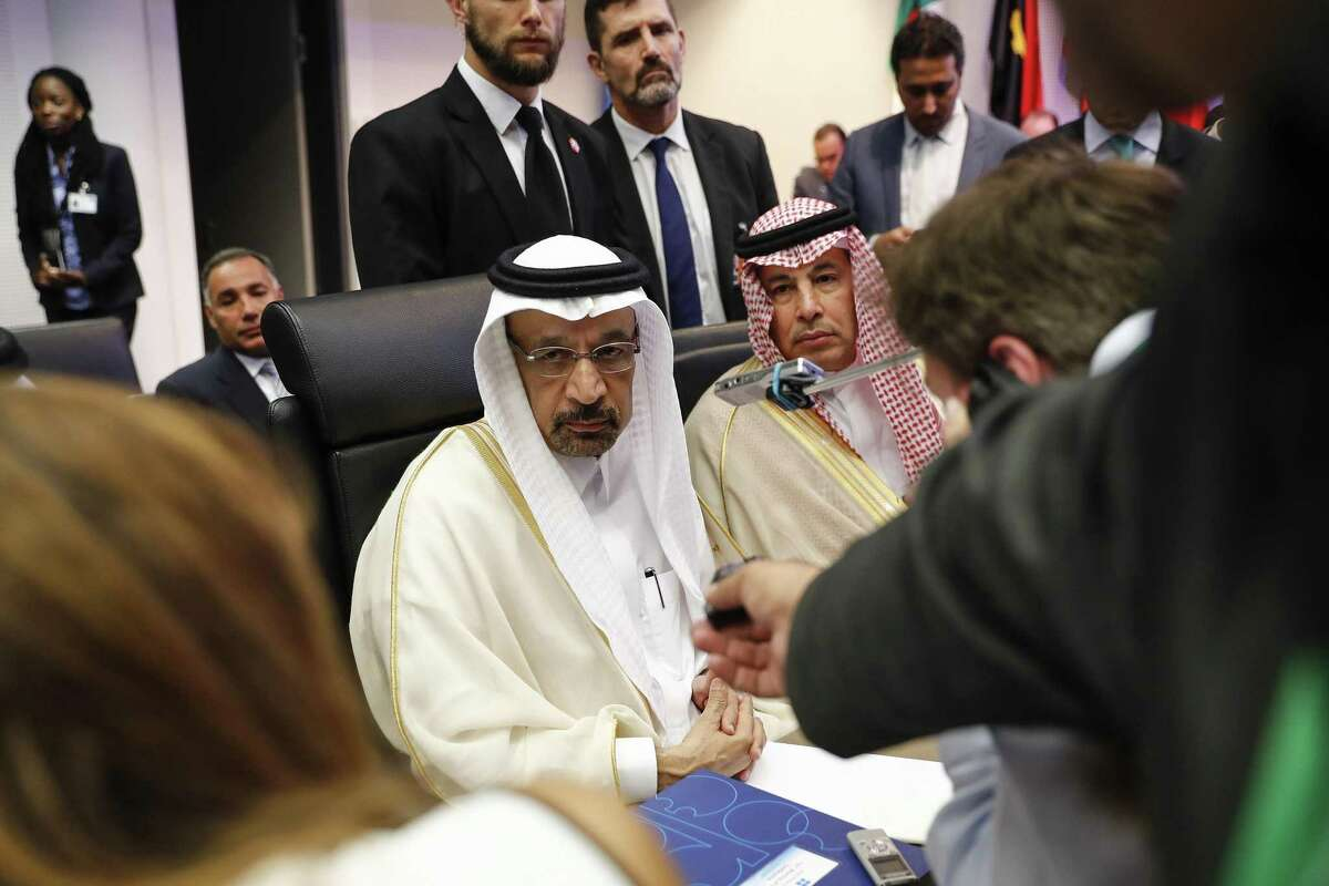 Khalid Al-Falih, Saudi Arabia's energy and industry minister, center, speaks to reporters ahead of the 174th Organization Of Petroleum Exporting Countries (OPEC) meeting in Vienna, Austria, on Friday, June 22, 2018. NEXT: See which countries are members of OPEC.