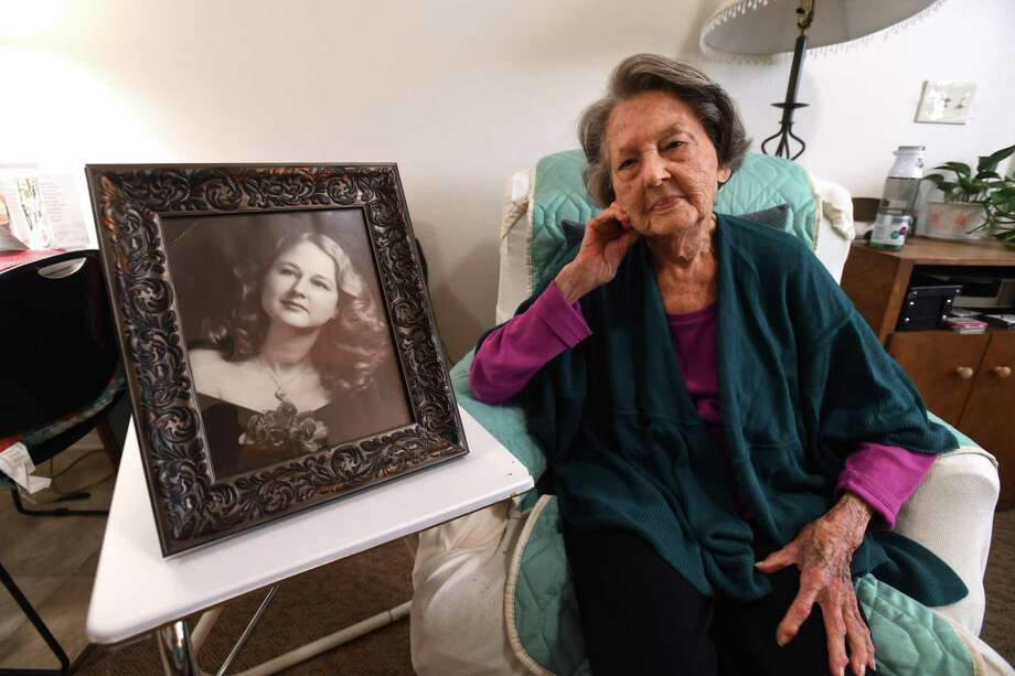 Estella Perkins sits next to a portrait from her youth on Friday. Perkins is celebrating her 102nd birthday today. Photo taken Friday, September 21, 2018 Guiseppe Barranco/The Enterprise Photo: Guiseppe Barranco, Photo Editor / Guiseppe Barranco/The Enterprise