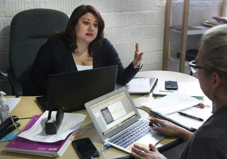Bexar County Democratic Party Chair-Elect Monica Ramirez Alcantara works with Transition Leader Frankie Gonzales-Wolfe in her office, on Friday, March 9, 2018.