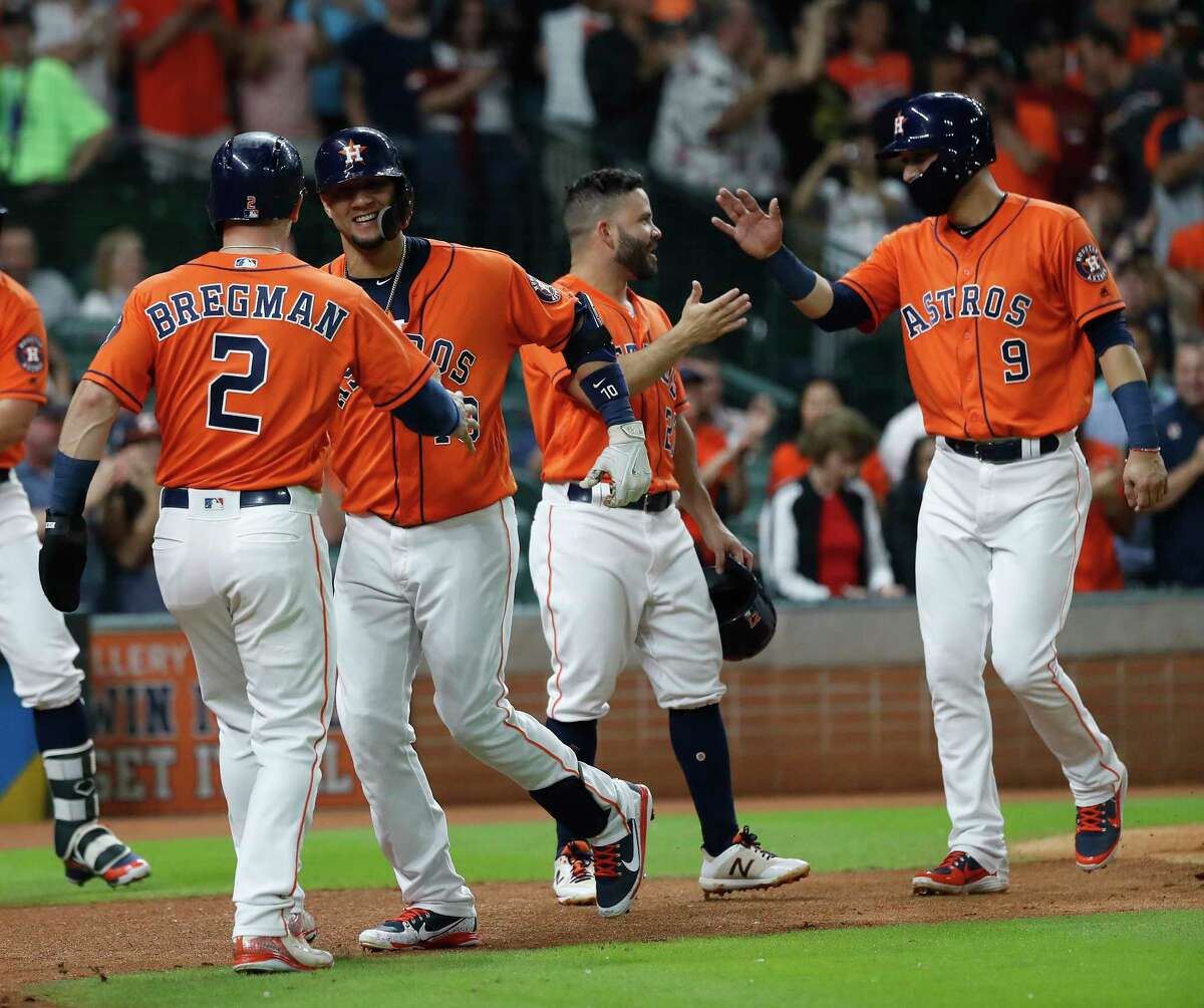 Houston Astros Yuli Gurriel (10) celebrates his grand slam with Alex Bregman (2) during the first inning of an MLB baseball game at Minute Maid Park, Friday, September 21, 2018, in Houston.