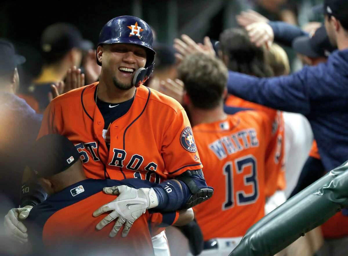 Houston Astros Yuli Gurriel (10) celebrates his grand slam with Tony Kemp (18) during the first inning of an MLB baseball game at Minute Maid Park, Friday, September 21, 2018, in Houston.