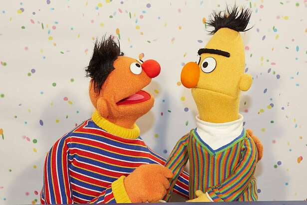 """Sesame Street"" Muppets Ernie, left, and Bert pose for photographs during a press conference on Jan. 7, 2013 on the 40th anniversary of the show's premiere in Germany. On Jan. 8, 1973, the children's television series first aired there. (Georg Wendt/DPA/Zuma Press/TNS)"