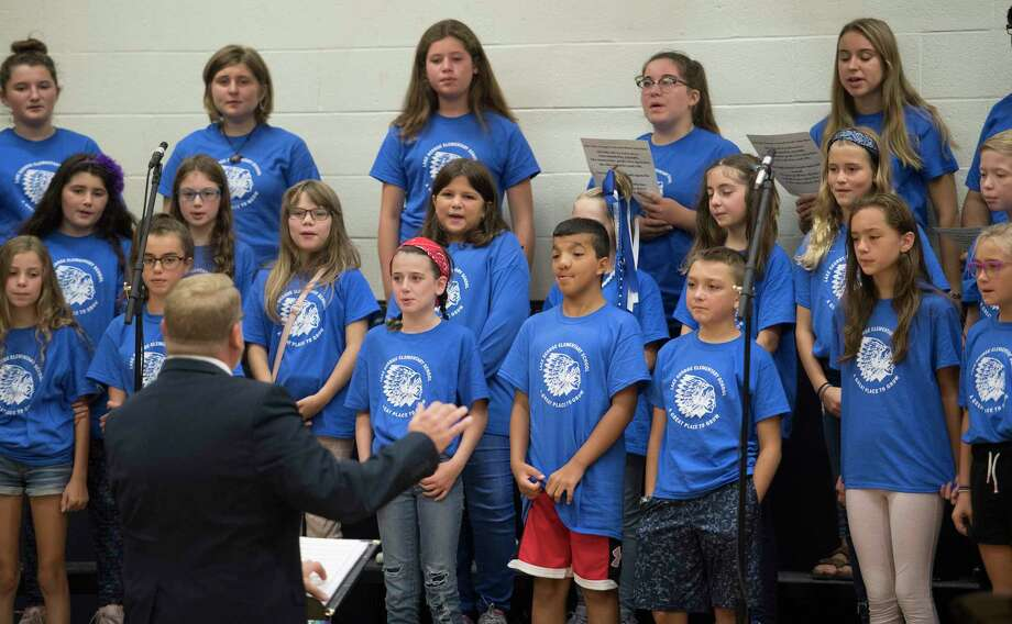 The Choir made up of students from Lake George Jr.- Sr. High School and the Lake George Elementary School serenades the assembly at the 50th anniversary celebration of the Lake George Elementary School Friday Sept.21, 2018 in Lake George, N.Y.  (Skip Dickstein/Times Union) Photo: SKIP DICKSTEIN / 20044832A
