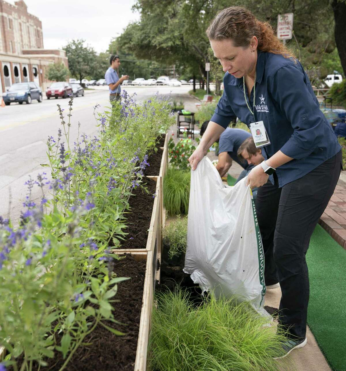 Stormwater analyst Michelle Garza helps prepare a tiny park that the San Antonio River Authority designed with local architects. The small park was fashioned from a curbside parking space along McCullough Avenue. The effort was part of Friday's PARK(ing) Day event, which aims to make urban spaces in cities across the country more inviting and walkable.