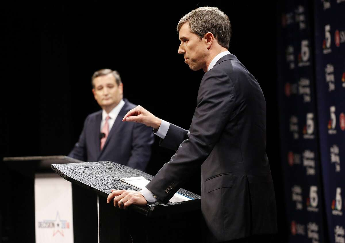 Rep. Beto O'Rourke (D-TX) makes a point as Sen. Ted Cruz (R-TX) waits his turn during a debate at McFarlin Auditorium at SMU in Dallas, on Friday, September 21, 2018. (Tom Fox/The Dallas Morning News/Pool)
